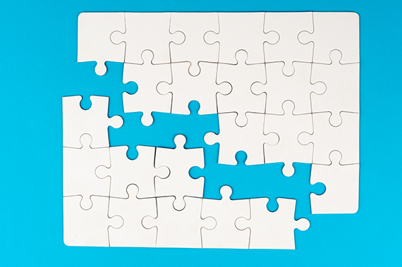 White puzzle pieces on a blue background