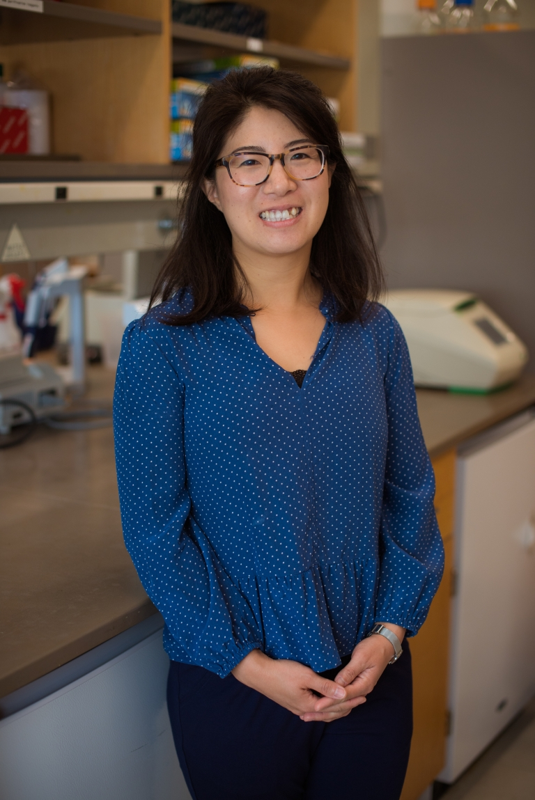 Pulin Li stands smiling in her lab.