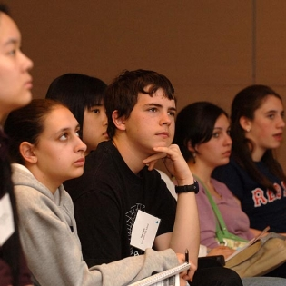 Five students looking up at a presentation.