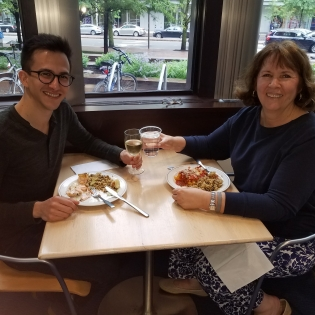 Two teachers eating at the Whitehead Institute Cafeteria.