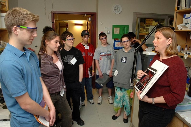 A woman speaks to a group of students in the lab.